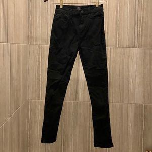 Black jeans with red stitching on pocket